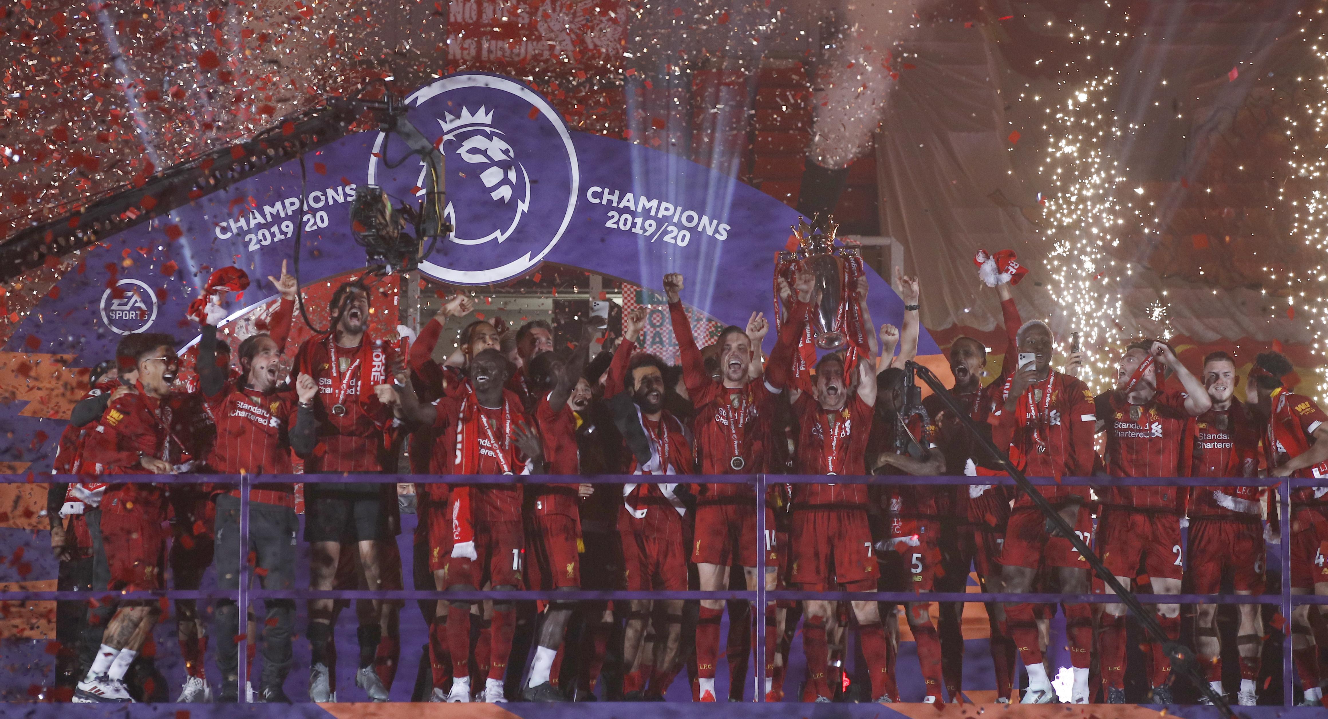 Liverpool Players Receive Premier League Trophy On Kop Yourbasin
